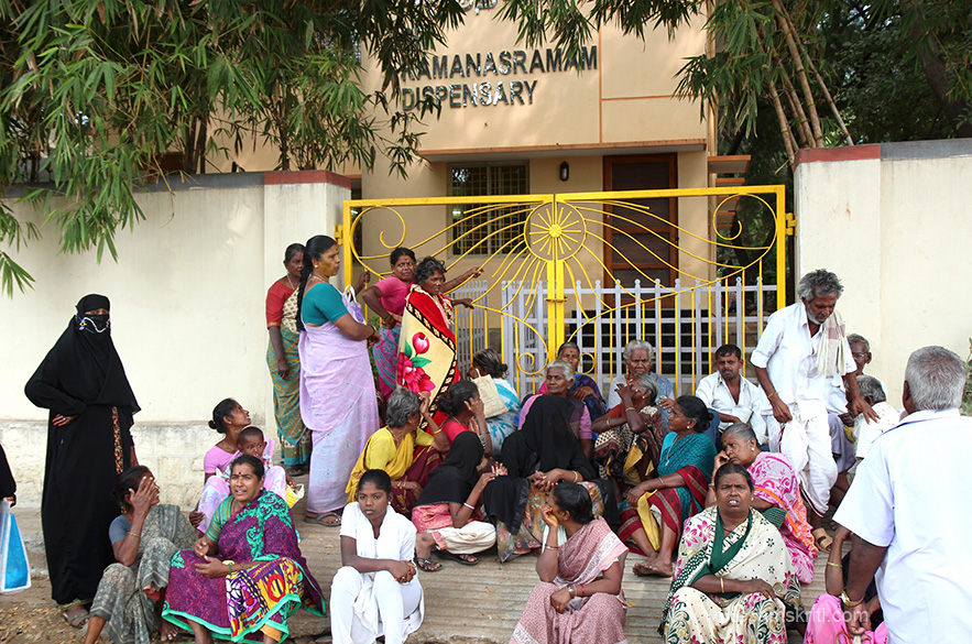 "People waiting outside the Ramanasramam dispensary. To see pics of Arunachala Mandir <a href=""http://www.esamskriti.com/photo-detail/Arunachala-Temple.aspx