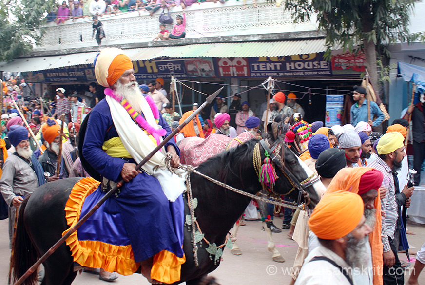 Nihang on a horse. There are different groups of Nihang warriors who had come for Hola Mohalla.