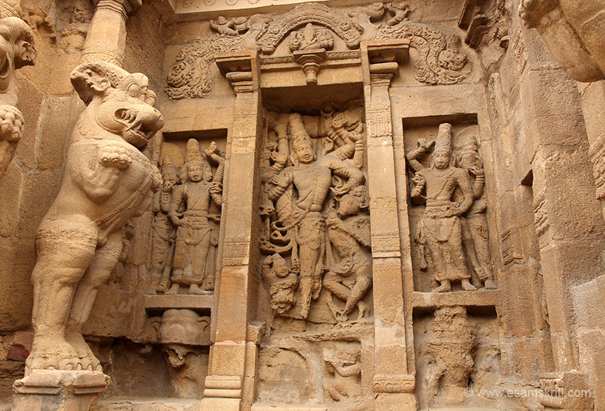South side image. Left is 3 headed Brahma with wife. Centre is Shiva. Right is Vishnu with wife. Please correct if wrong.