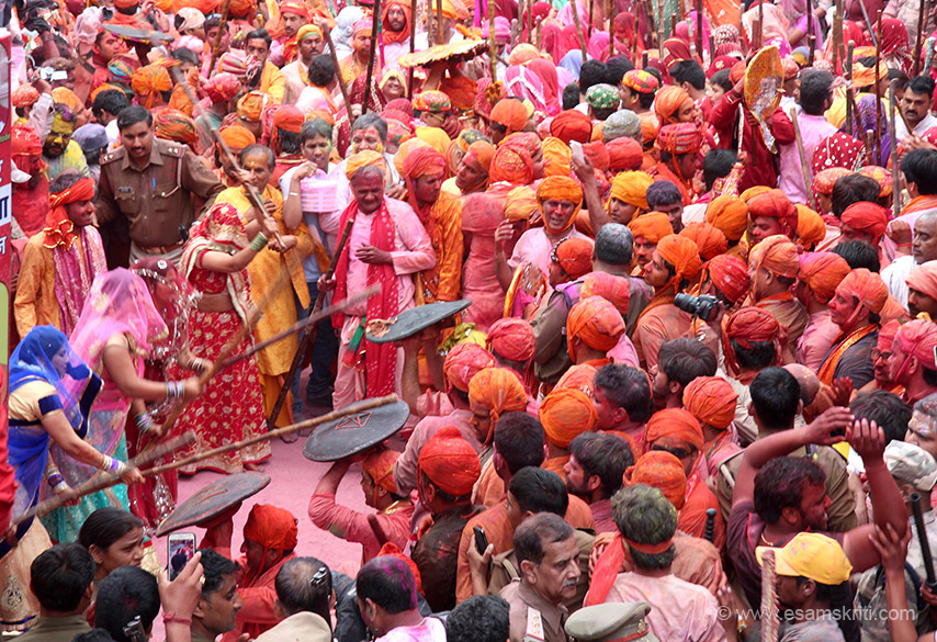 Women hit with full strength, sometimes one to one, two is to one or even four sticks on a man``s head. Next day Lathmar Holi is celebrated in Nandgaon whose pics we present separately.
