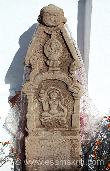 This old stone was found in one of the villages and brought to the temple.