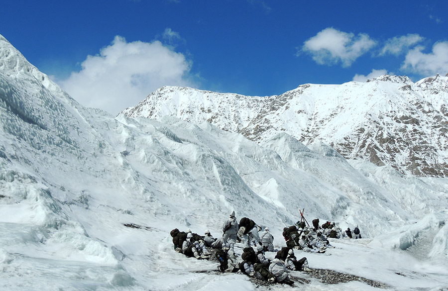 Jawans camping after a walk, notice their bag size. At base camp jawans are taught ice craft, rock craft, survival skills, rescue drills say from crevices/avalanches and maintaining base fitness.
