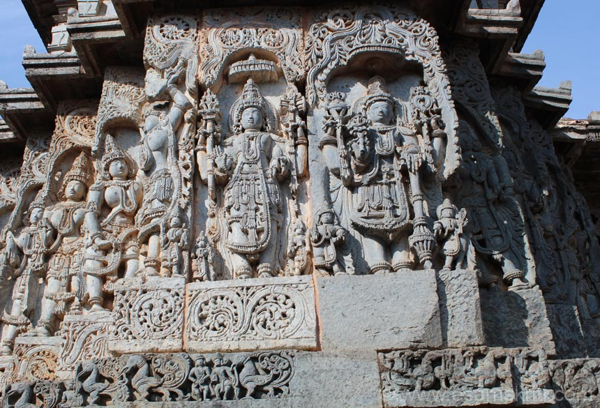 A close up view. Left is Lord Shiva, right is Lord Vishnu. Images of left and right of the two Gods are those of dancers.
