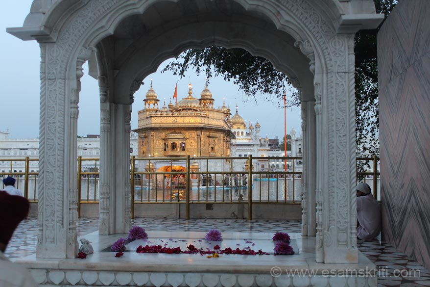 A view of the Hari Mandir thru the arch at Tharha Sahib. Guru Ram Das and Guru Arjun sat here and supervised work of the tank. Early morning pic.