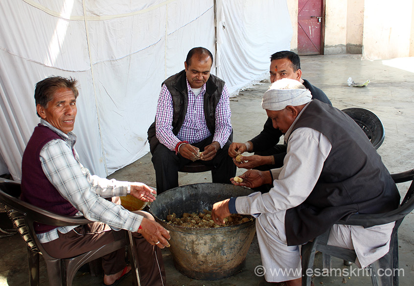 Group of retired men peeling boiled potatoes. Area where langar was is actually a open hair hall with stage. Hope to visit Naina Devi in peak winters some day.