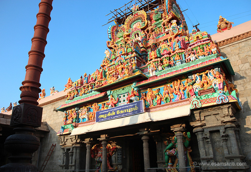 Close up of gopuram with door keepers and flagpost.