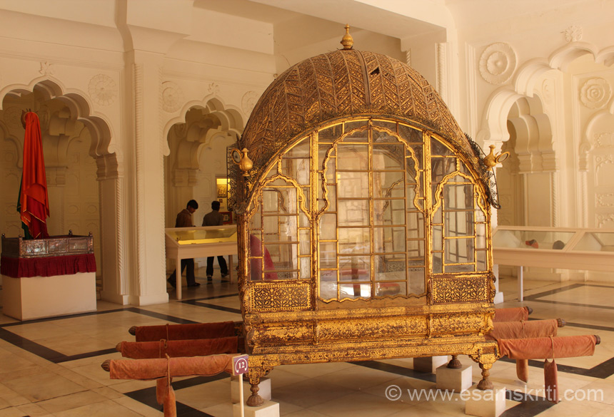 A view of the palanquin. It is executed in rich Gujarati tradition of carved and painted woodwork. The museum is very well laid down and maintained. Artifacts are well preserved. It is 