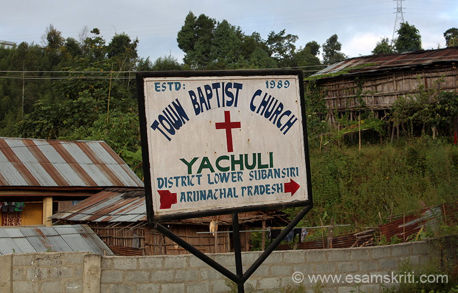 Another sign board. In such cases looked for the Church but not visible. May be they are lower down or inside a colony.