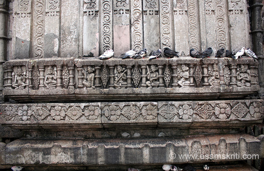 """Reliefs in lower part of temple wall. Temple has images of 64 Yoginis and 18 Bhairavas. To see pics of 64 Yogini temple near Bhubaneshwar <a href=""""http://www.esamskriti.com/photo-detail/64-Yogini-Temple.aspx"""" target=""""_blank"""">Click here</a>"""
