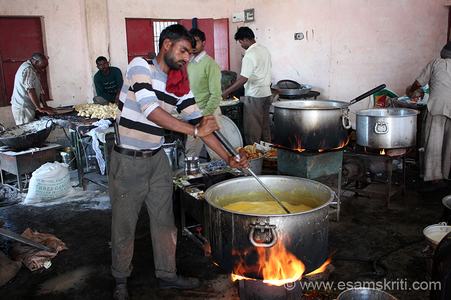 Making kadhi (right in front) and puris behind. The temple trust also runs a free langar service not sure if it is this one.