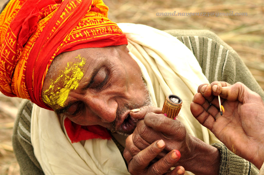 Smoking a little marijuana on the banks, just before his dip, which will most definitely wash away his sins! To see pictures of Kumbh Mela 2010 Haridwar <a target=_blank href=http://www.esamskriti.com/photo-detail/Kumbh-Mela-2010.aspx>Click here</a>