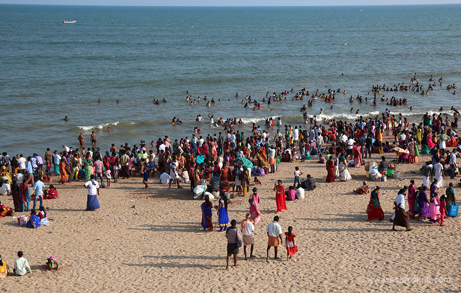Another view of devotees in the Bay of Bengal. We went on to the first floor of a structure to click this. Whilst coming down the plaster on chajja gave away, lucky no injury.