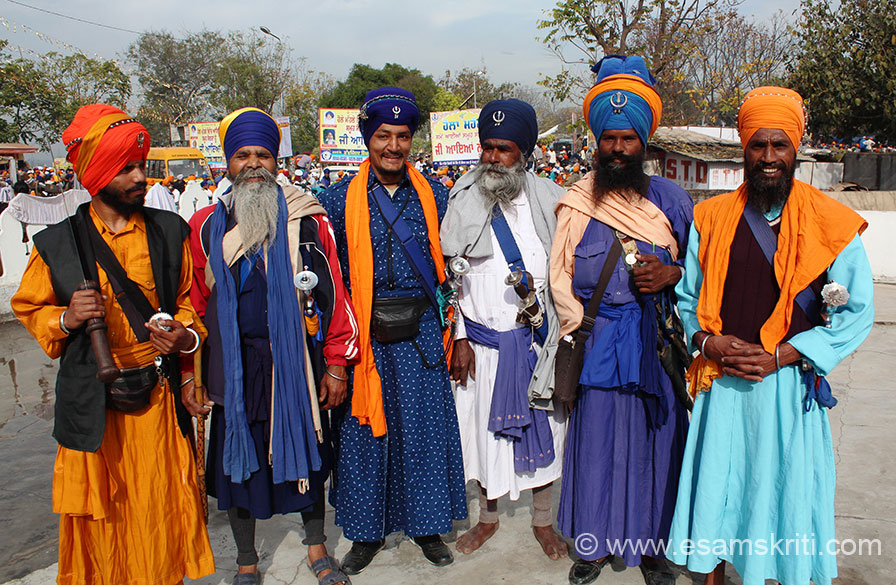 "I met these smiling men somewhere on Hola Mohalla day. To know more about Shri Keshgarh Sahib <a href = ""http://rupnagar.nic.in/html/SriKeshGarhSahib.htm"" target = ""_blank"" > Click here </a>"
