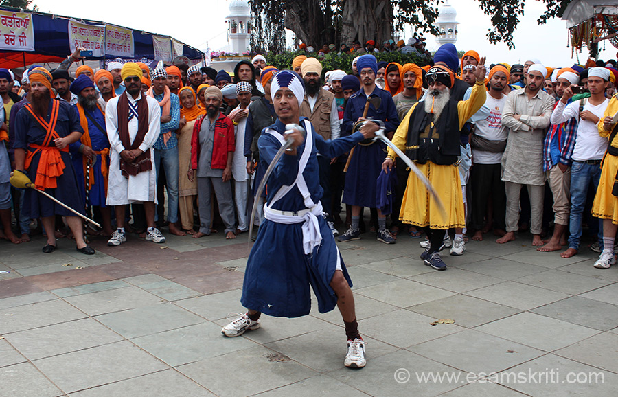 Hola Mohalla is also about showing how masculine you are. On Hola Mohalla day Nihangs display their prowess at the Sri Kesgarh Sahib Gurudwara. U see an example. It