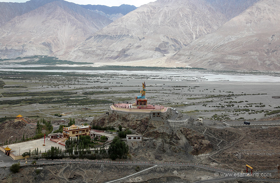 "From Diskit Gompa view of Maitreya Buddha statue with Nubra Valley in the backdrop. It is a 32 metre statue of Jampa Buddha which dominates the hill below the monastery. ""It is said to be 