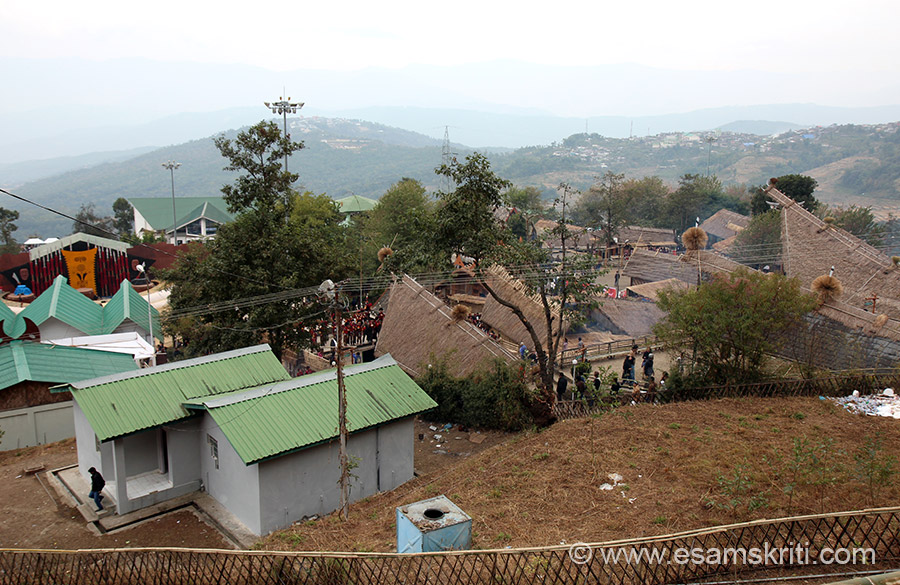 My dream of visiting Hornbill Festival in Kohima came true in December 2014. Festival is held in Naga Heritage Village ie some 15 kms away from Kohima. Festival displays house and clothing of each Naga tribe. Also tried to get pic of each tribe so u see their dress. View of festival area from a height. Light brown colored piece on left of pic is where dances are held.