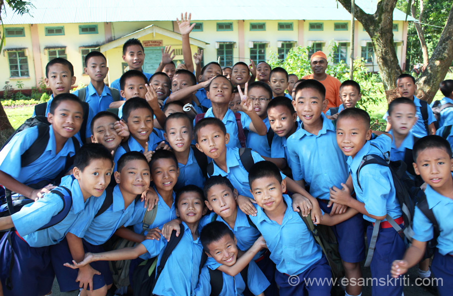 In September 2013 had the pleasure of driving thru Arunachal Pradesh. Started with Ramakrishna Mission School, Deomali, Tirap district in the west. Then to Tezu, Roing, Along, Ziro,  Itanagar and Tawang in the east. All thru trip met hundreds of Arunachali children of all ages. Found them to be very bright and intelligent. U see boys of RKM school. They were going for morning assembly when I asked them to pose, very enthusiastic.