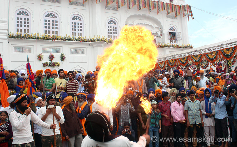 This collection shows you GATKA (Nihang games) outside the Sri Keshgarh Sahib on Hola Mohalla day 2014. Young boys put oil in their mouth, then throw out oil with full force on a stick ie lit the result is what you see. Photo captions has description of pic and history of Gatka/other Indian Martial arts, info taken from various sites.