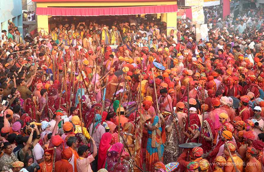 Day 1 is Laddoo Holi at Barsana, day 2 is Lathmar Holi at Barsana, day 3 is Lathmar Holi at Nandgaon that you see. The two villages are only 7 kms away but celebrations have a different feel to it. Women of Barsana beat men of Nandgaon on day 2. Next day it is the reverse, women of Nandgaon beat men of Barsana with sticks.