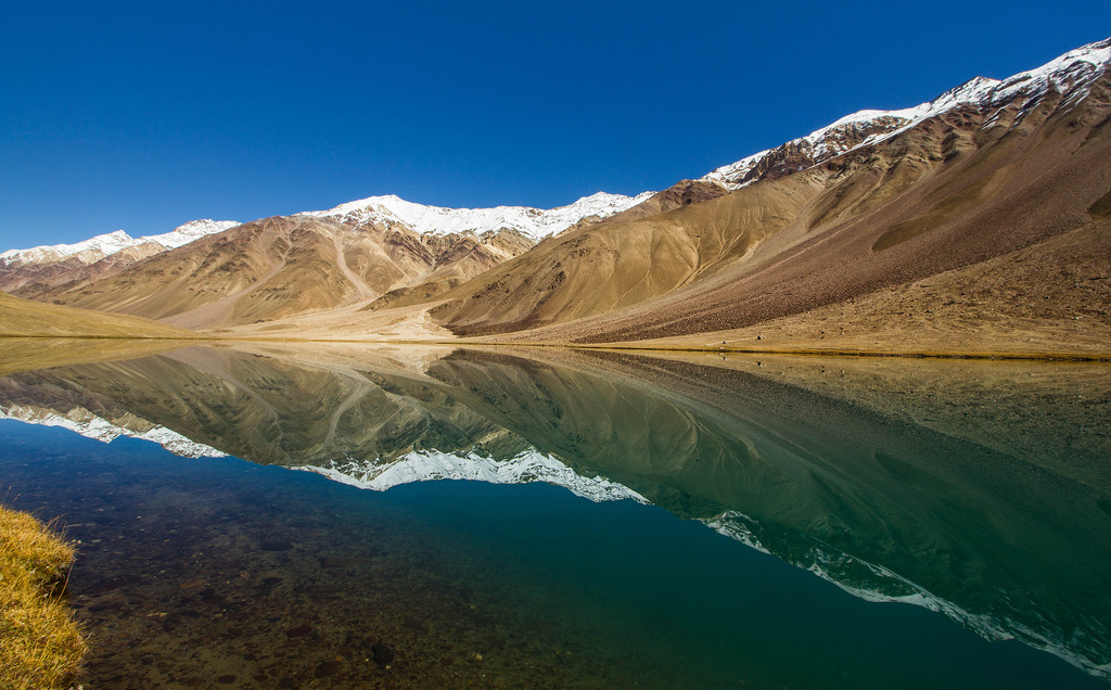 Chandratal Reflection. How to reach Chandratal. From Manali take a bus to Kaza, get off enroute at Batal, spend the night at a Dhaba and then trek 14kms next day to Chandratal. It is at a height of 4,300 metres so always better to let body adjust to high altitude. OR take a Sumo from Manali 140 kms cost app Rs 10,000 says blogger Mridula D.