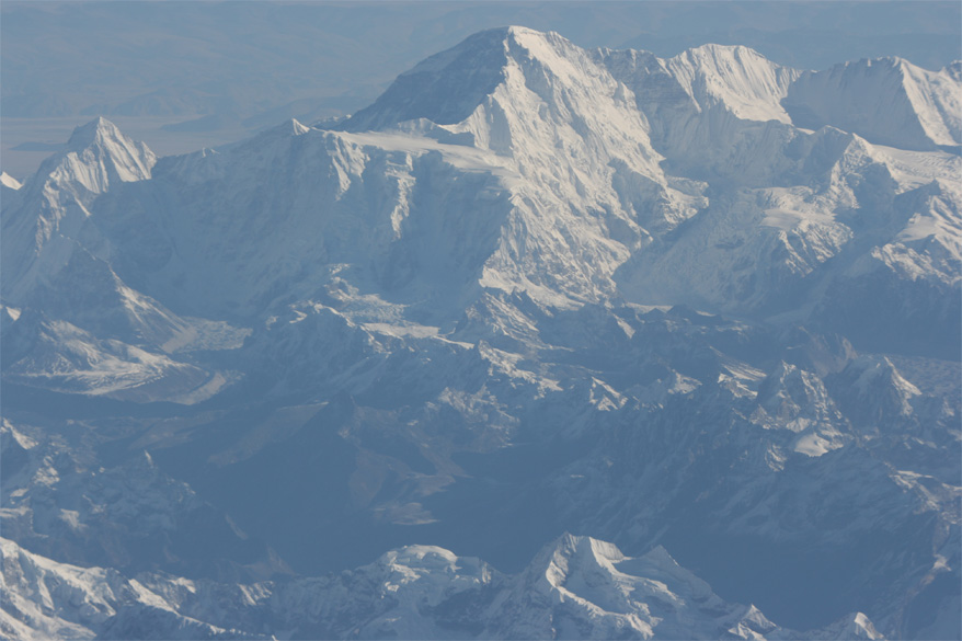 This is Gaurishankar (7181 metres). There are actually two summits, the northern and taller one is called Shankar and the southern one is called Gauri. To see pics of Mount Everest on flight to Paro <a target=_blank href=http://www.esamskriti.com/around-world/Bhutan-Vignettes.aspx>Click here</a>