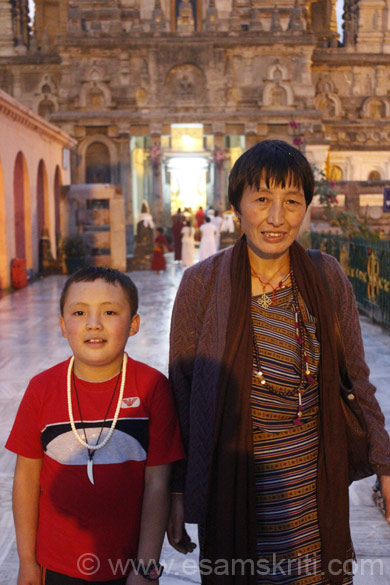 Bhutanese child with his Grand Ma. Background is entrance to main temple. The purpose of this section is to show you pics of people of different nationalities, followers of Buddha for whom a trip to 