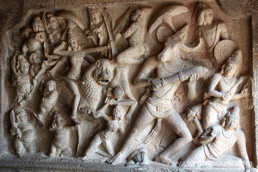 Left of pic Mahishamardini is shown in the relief as 8 armed riding her lion, equipped with all weapons and using bow with its string pulled up to her ear. She is attended by a hosts of ganas and amazon yoginis and is in the ear like alidha posture using a huge club. This is probably one of the most remarkable representations of Mahishamardini in a group, another is at Ellora.