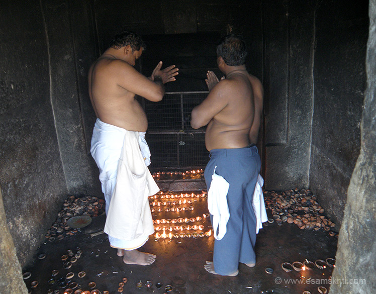 Devotees praying to Lord Vishnu. The temple priests told me that I should consider myself blessed that had darshan of this holy spot. He was amazed when I told him how I came there thinking was going to a Surya temple.