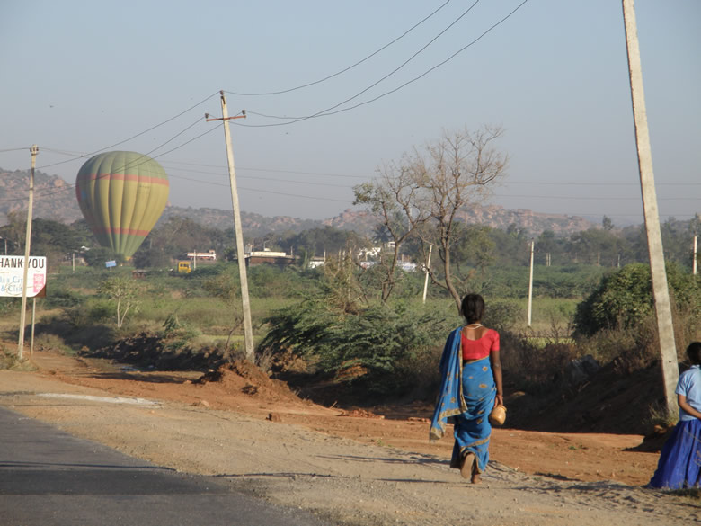 One of the two balloons lands. Clicked this picture from a speeding car. Being part of the ground team had to be there in time for landing.