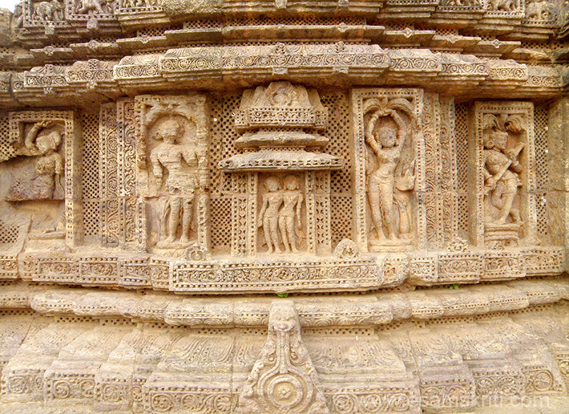 Close up of images that is just below pillars. Centre looks like two ladies, next lady with arms raised over her head and last is lady with what I think is a musical instrument may be Veena.