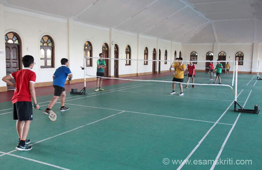 Students playing badminton. The structure under construction is a library. To visit site of Vishwashanti Gurukul http://mitgurukul.com/