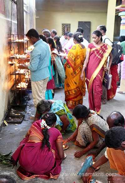 "Devotees lighting the lamp or deepam. ""This is an ancient Saivite shrine where tradition has it that Kethu, one of the 9 celestial bodies central to astrological beliefs worshipped  Shiva."""