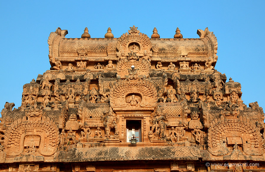 Close up of top part of gopuram 3. In centre is Ganesha above whom are Kirti Mukha at 3 levels. On either side of Ganesha is Kirti Mukha (face of animal) ie meant to keep away evil spirits.