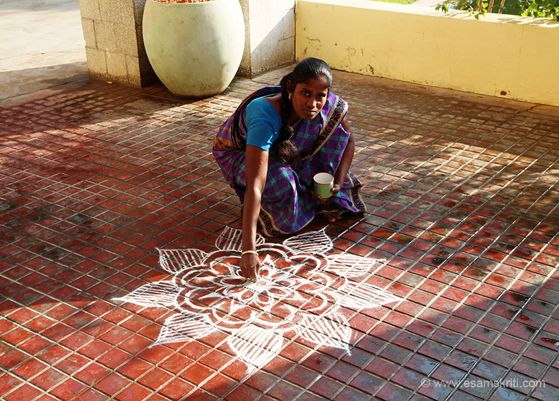 "Local lady drawing KOLAM at hotel entrance. To read briefly about Chettinad architecture <a href=""http://www.thebangala.com/architecture.html"" target=""_blank"">Click here</a>"