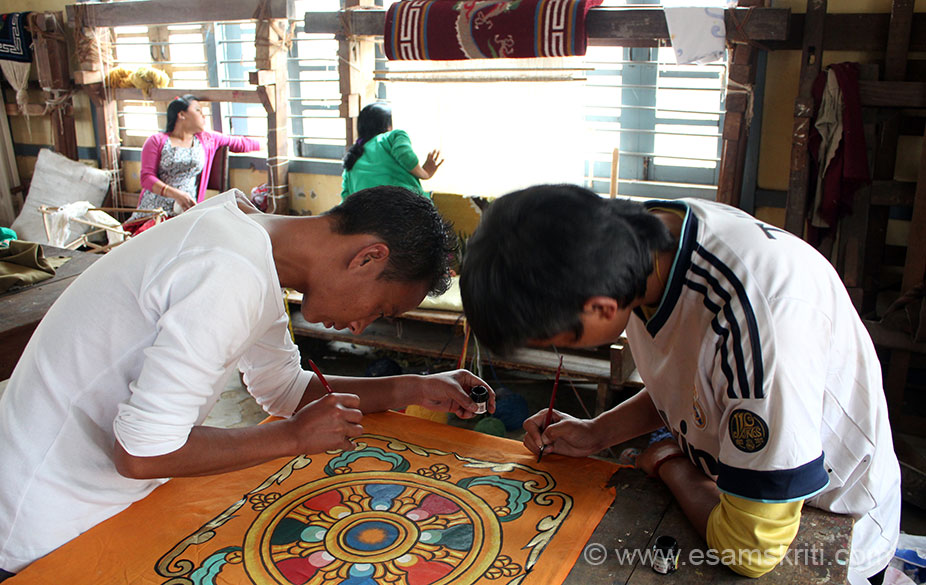 Painting at the Bomdila Craft Centre. Locals are Monpa tribe who are followers of Buddhism.
