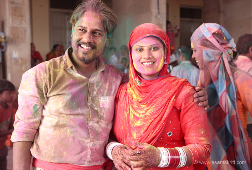 Newly married couple, indicated by the red chudhas worn by lady.