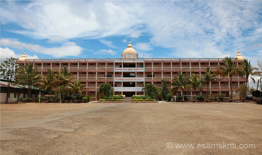 "Building of the English medium school. The ashram has a temple, meditation centre, rooms for devotees to stay, schools, rooms for children to stay. Place has very positive vibrations. It is on the Shirdi-Kpargaon road. Number is 02423 285166. Site is <a href=""http://www.vishwatmak.org"" target=""_blank"">Click here</a>"