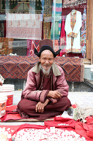 This man selling some crystal stone, think removed from river, in main market Leh.
