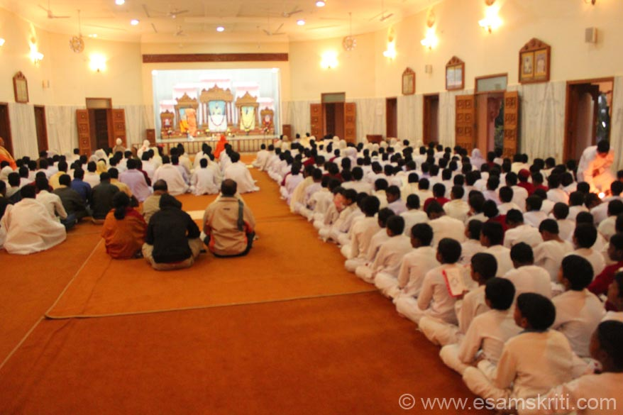Hall where students praying. Mission was set up in 1985. It is involved in Education, Health Care, Integrated Rural Development Program, Vishwas (a sister institution) and runs an ITI. It also