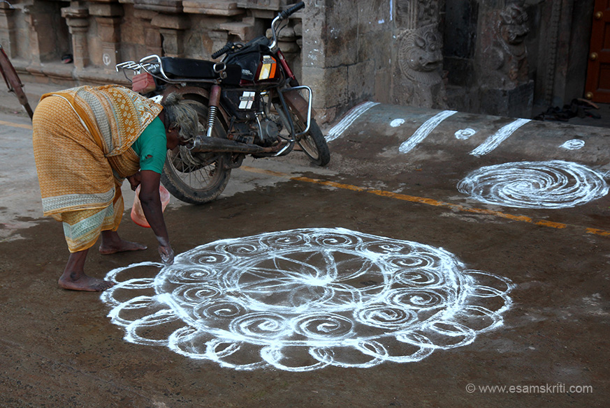 "It was Pongal time. During the month of Margazhi (dec15-jan15) it is customary for women in Tamil Nadu to get up early in the morning and draw the KOLAM in front of the  house. Here it is being done in front of temple. ""Vanmikanathar represents the Moolavar while the shrine dedicated to Thiyagaraja is the better known shrine in the temple. Thiyagaraja (Somaskanda) image