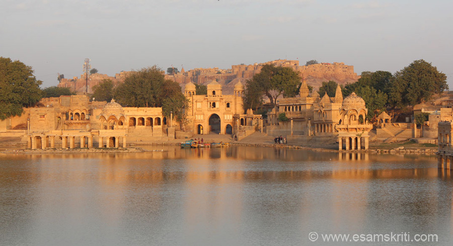 Early morning view of Jailsamer Fort from Gadisar Lake. Must go to Gadisar Lake thrice during the day. Sunrise for sure, during the day for boating and puppet show and perhaps at sun