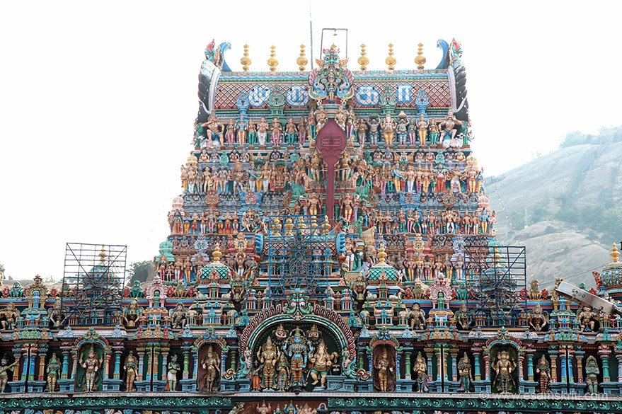 "Close up of Rajagopuram. ""An Aasthaana Mandapam with several artistically carved pillars lead one to the towering 150 feet (46 m) high Rajagopuram at the entrance."""