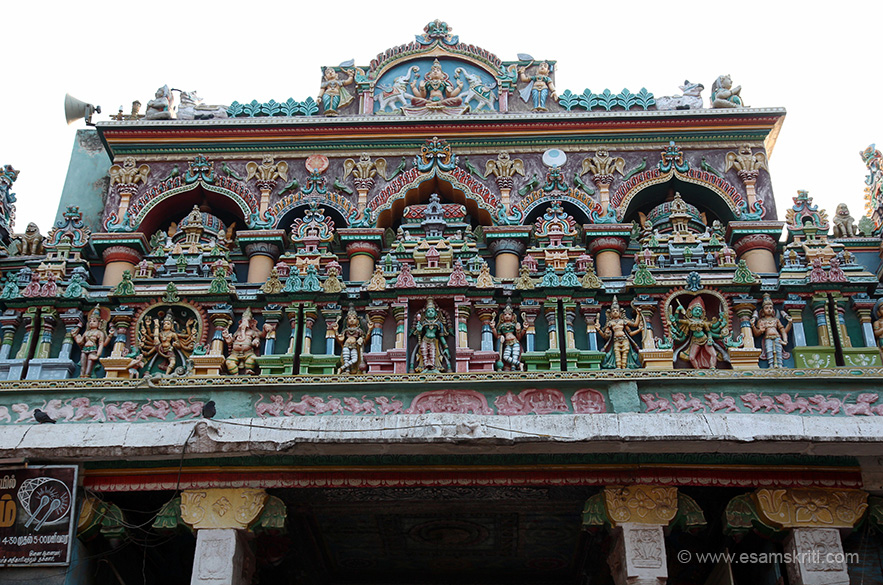 Entrance to temple - think from south side. Centre you see temple flanked by vimana design on both sides. Images left to right is with multiple hands, one foot in air, next is Ganesha, centre below temple is man and extreme right is women not sure whom they represent.