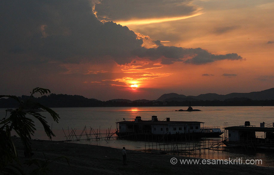 """Sunset at Brahmaputra river. ``The Kamakhya Mandir in Kamrupa had become already established as an imp Centre to Tantric worship (both Buddhist and Hindu), according to the Hevajra Tamra (8th century A.D.) etc``. To read a very good historical note on Sri Sri Kamakhya in Kamrupa <a href=""""http://www.jaimaa.org/articles/a-historical-note-on-sri-sri-kamakhya-temple/"""" target=""""_blank"""">Click here</a>"""
