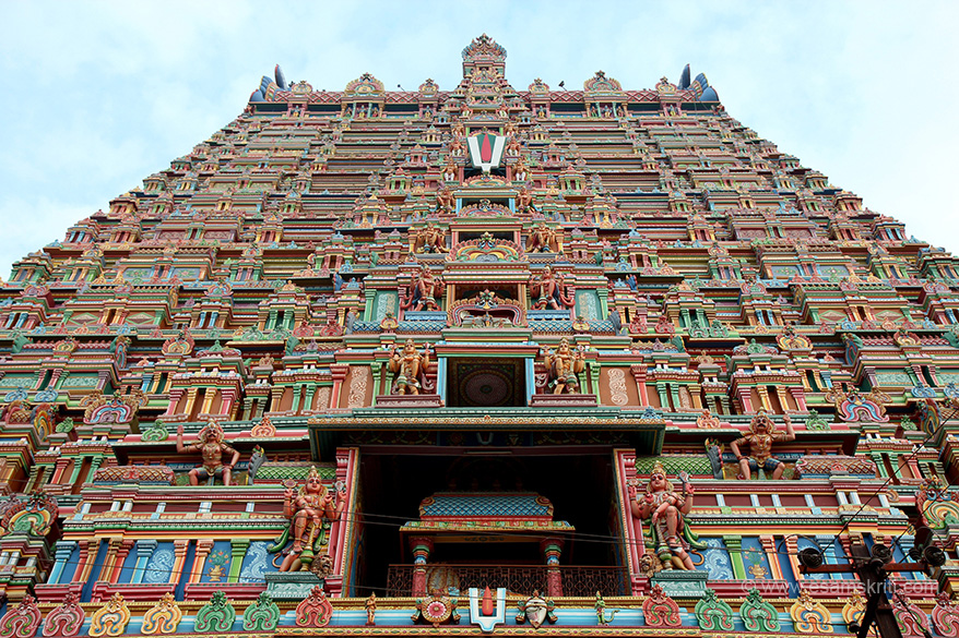 "Rajagopuram front view. Lord Vishnu in reclining posture. Importantly note in centre at each level painting in ceiling. ""Out of the 108 DivyaDesas (sung by Vaishnavite Alwars), this is the only