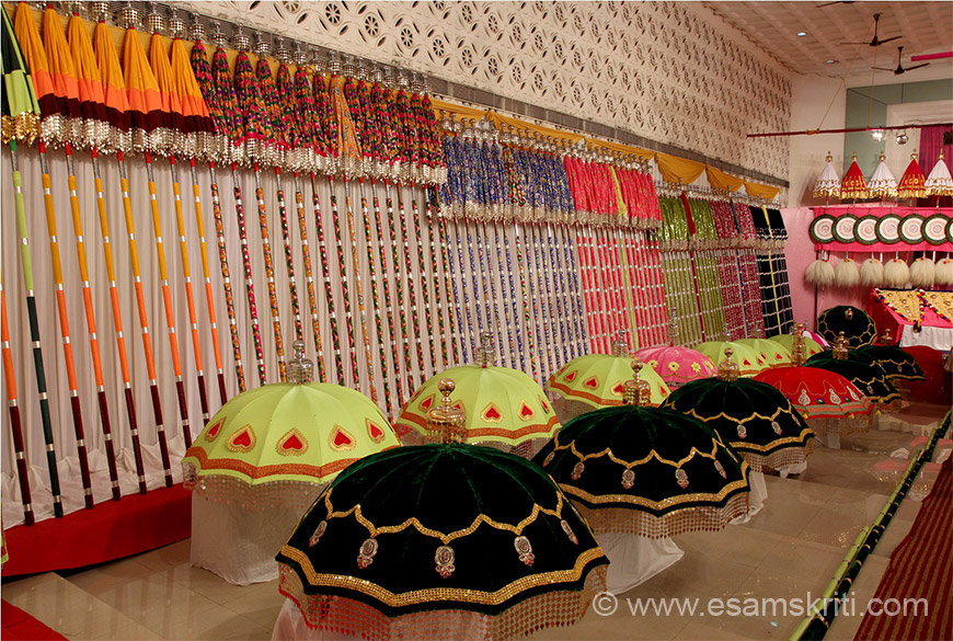 "During festival elephants are dressed up with ornaments. Cloth above wooden stick is called KUDA as is green colored umbrella. This is left side of hall. To know all about festival <a href=""http://thrissurpooramfestival.com/thrissur_pooram.html"" target=""_blank"">Click here</a>"