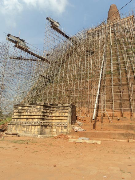 Huge crains were installed to carry out the restoration work right at the top of the stupa. I had the good fortune to be transported to the top level of the stupa where the stones are original