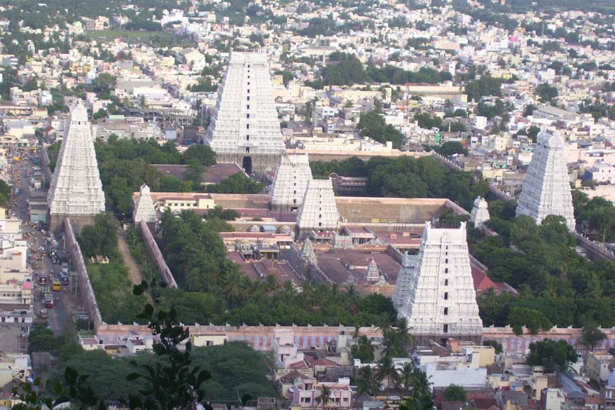 Another view of the temple taken from top of the Arunachala Hill. Note the gopurams on four sides and in the centre as well.  The temple has a unique architecture with a 66 metre high gopuram consisting of thirteen storey tier. The temple has seven prakaras and nine gopurams. The tallest gopuram was built by king Krishnadevaraya in the fifteenth century &  it is believed to be the second tallest gopuram South India. This tower is called as Rajagopuram located on the eastern side.