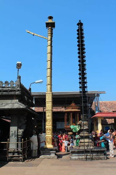 "Left of pic gold color is  ""dwajasthambha"" - the flag post of the deity. During special festivals the flag of the deity is invariably hoisted after performing the prescribed rituals. On right is 