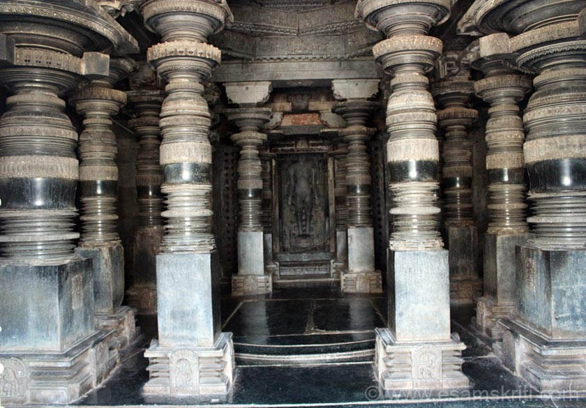 Bellshaped polished pillars inside the temple. Close up of Tirthankara in next image.